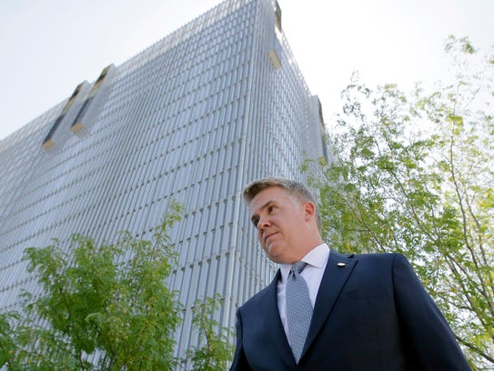 U.S. Attorney John Huber leaves the federal courthouse