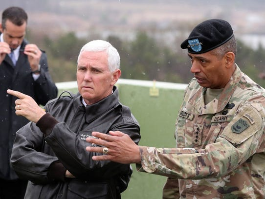 Vice President Mike Pence, left, is briefed by U.S.