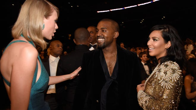 Taylor Swift, Kanye West and Kim Kardashian attend The 57th Annual Grammy Awards on February 8, 2015.