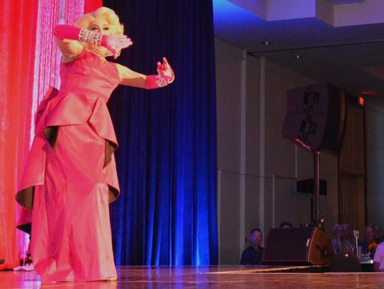 Emcee Ethylina Canne performs at the Desert AIDS Project's