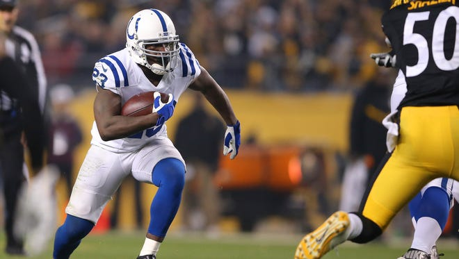 Indianapolis Colts running back Frank Gore (23) runs the ball out of the backfield during the first half of an NFL football game Sunday, Dec. 6, 2015, at Heinz Field, in Pittsburg, Pa.