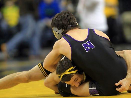 Iowa's Thomas Gilman wrestles Northwestern's Garrison