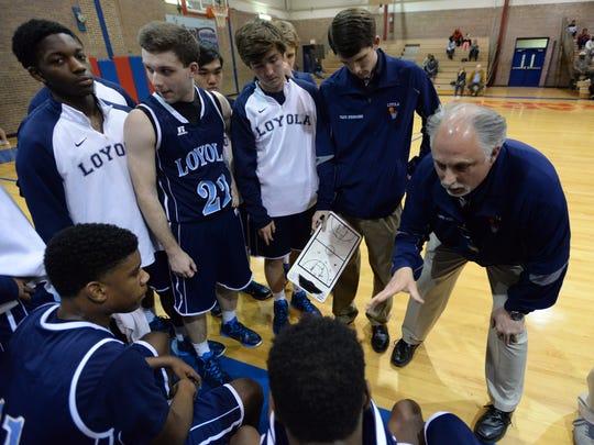 Loyola head coach Bill Keel talks to his team between quarters against Woodlawn.