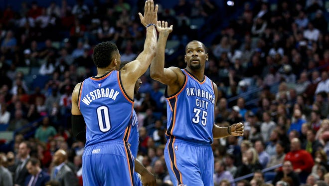 Oklahoma City Thunder forward Kevin Durant celebrates with guard Russell Westbrook after scoring against the New Orleans Pelican.