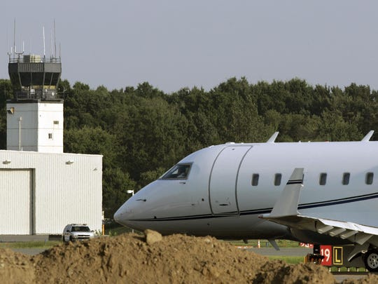 A control tower can be seen as a small passenger jet taxis past airport construction while waiting for clearance to take off from Teterboro Airport, Aug. 15, 2009. (AP Photo/Mel Evans)