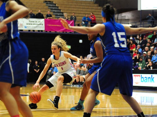 South Salem guard Katie McWilliams drives to the basket against St. Mary's during the championship game of the OSAA class 6A basketball tournament inside the Chiles Center, on Saturday, March 14, 2015, at the University of Portland.