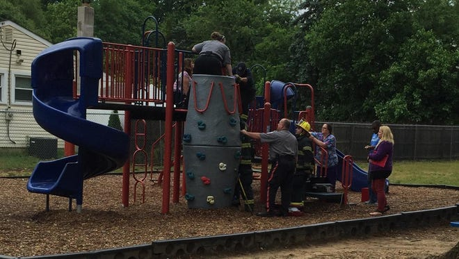 Rescue and fire department crews freed a Dane Barse Elementary School student who got stuck in playground equipment Tuesday afternoon.