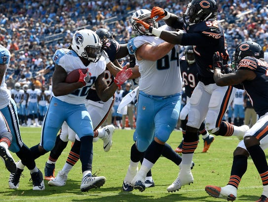 Titans running back Derrick Henry (22) goes in for