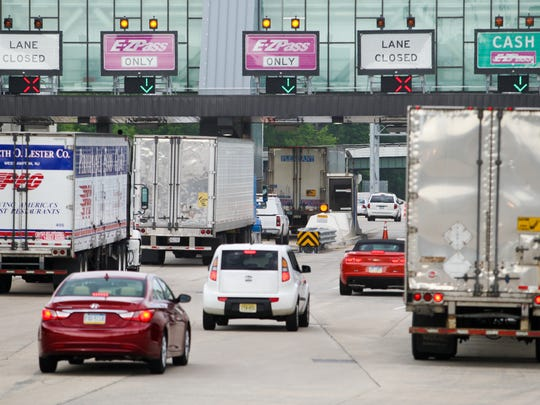 Vehicles use E-ZPass lanes on I-95 at the Newark toll plaza.