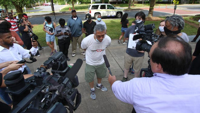 The local news media interviews some of those in favor of removing the Confederate Heroes monument in front of the Gaston County Courthouse Tuesday evening, June 23, 2020.