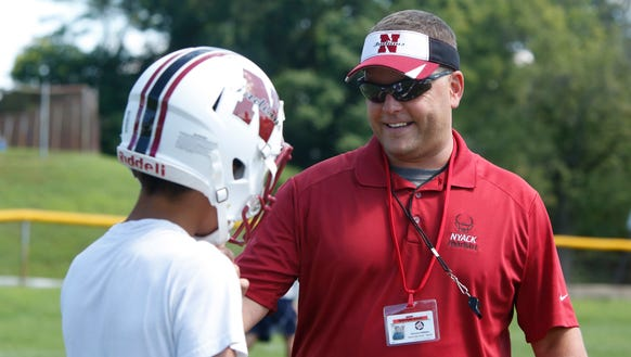 Dominick DeMatteo, Nyack's new football coach, leads