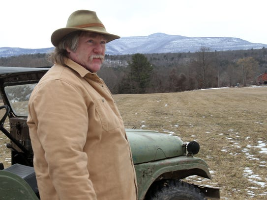 Clay Trumpbour, a 9th generation farmer, looks over