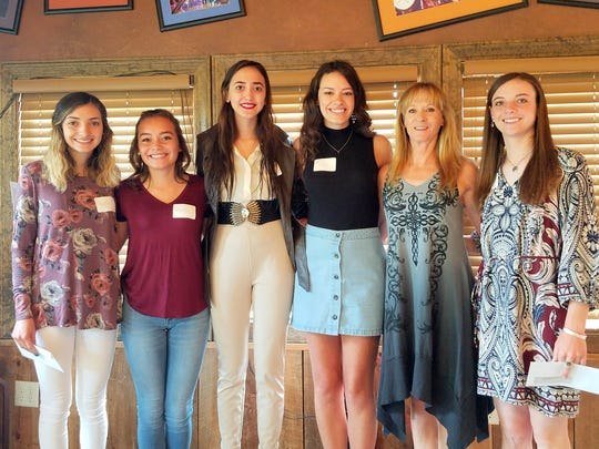 Darien Ross, chairman of the RLCAR scholarship committee, was joined for a photo by recipients from left, Naomi Chavez, Kathryn Fernandez, Jazmine Nava, Breck Gavin and Joyce Anne Cooper.