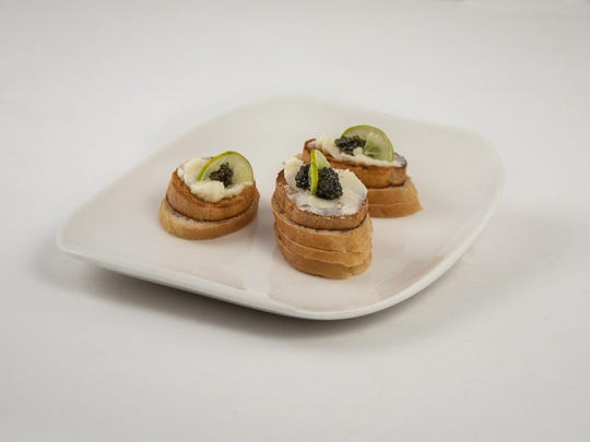 Persian-style caviar is topped with lime lunettes offering a spurt of sourness to contrast with the saltiness of roe.