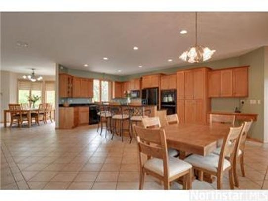 The kitchen is complete with granite countertops and