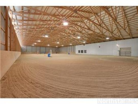 An indoor riding arena totals  150 feet by 250 feet,