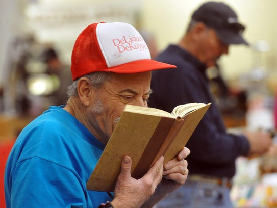 Richard Mann reads a book about George Custer at the