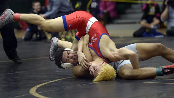 Penfield freshman Frankie Gissendanner, in grey, wrestling Fairport's James Arao during the 2015 Section V Class AA Championships.