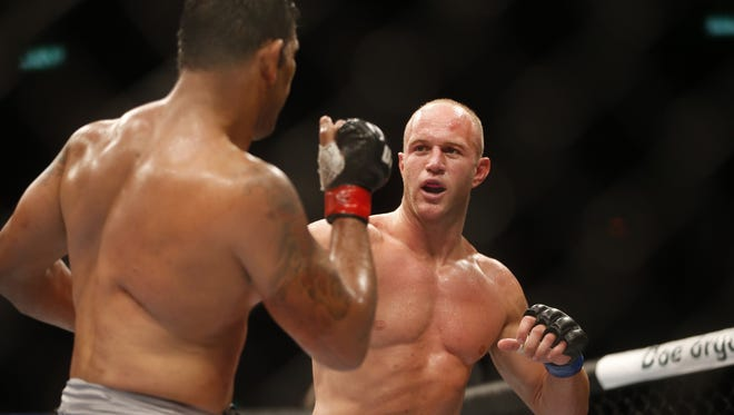 Minotauro Nogueira, left, from Brazil, fights Dave Herman, from the United States, during their heavyweight mixed martial arts bout at UFC 153 in Rio de Janeiro, early Sunday, Oct. 14, 2012. Nogueira defeated Herman.