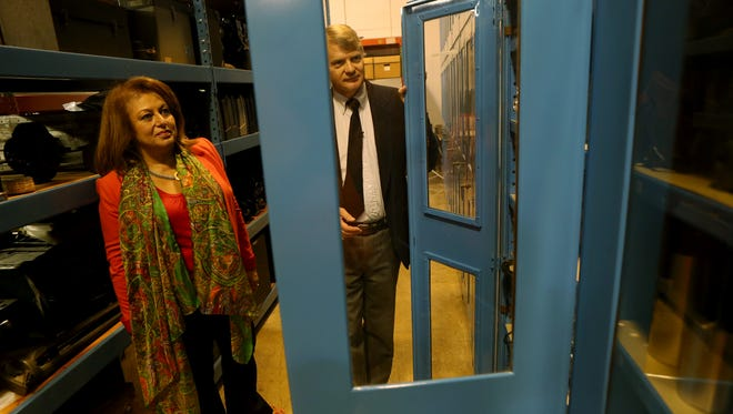 Todd Gustavson, curator of the Technology Collection at George Eastman House gives Madiha El-Mehelmy Kotb with ASME a tour of the vault housing George Eastman House's historic collection of camera technology.