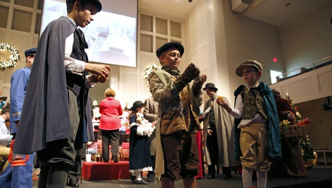 Children take to the stage at the First Baptist Church Wednesday during a dress rehearsal for their upcoming performance of 'Come Home for Christmas'. The church's annual Christmas play is scheduled for this Sunday at 6 p.m.