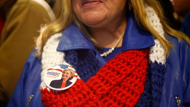 A supporters wears her Hillary Clinton button as she waits for President Bill Clinton and daughter Chelsea to come out Saturday Jan. 16, 2016 at a rally for Democratic presidential candidate Hillary Clinton at Lincoln High School in Des Moines.