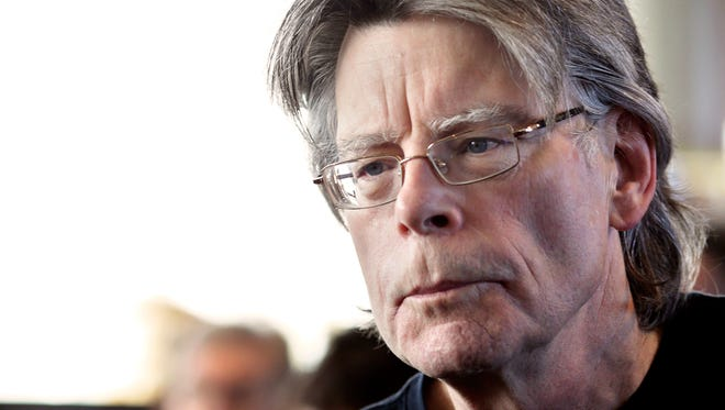 American author Stephen King poses for photographers on Nov. 13, 2013 in Paris. He's coming to Iowa City this summer.