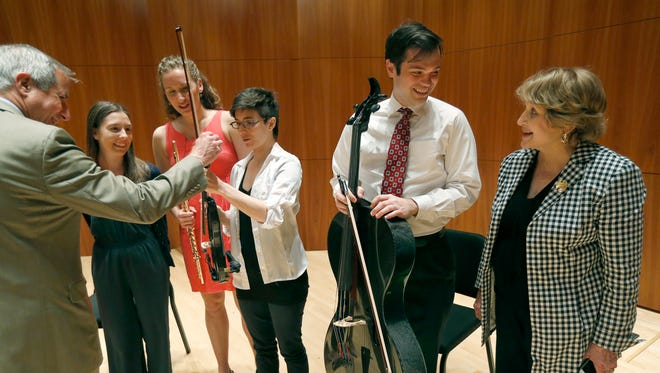 Dean of the Eastman School of Music Jamal Rossi and Louise Slaughter chat with music students Aristea Mellos, Emlyn Johnson, Hanna Hurwitz and Daniel Ketter after their performance and a press conference on the importance of the arts in the new wing of the Eastman School of Music.