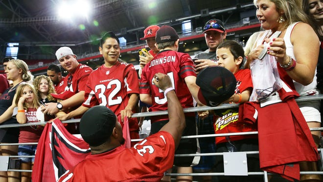 Arizona Cardinals David Johnson signs autographs during the opening day of training camp on Jul. 22, 2017 in Glendale, AZ.