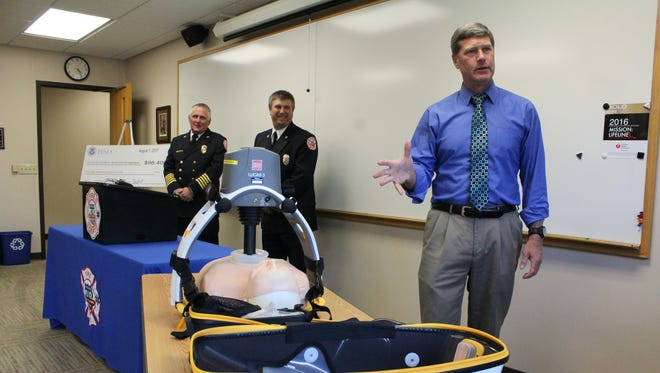 U.S. Rep. Ron Kind talks with officials Monday afternoon at the Stevens Point Fire Department.