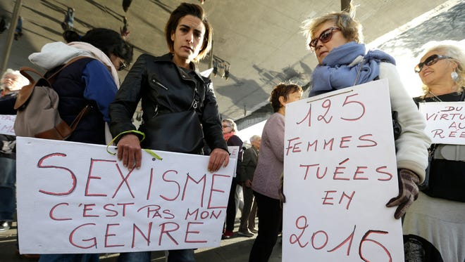 In this Oct. 29, 2017, file photo, demonstrators hold placards during a demonstration against sexual abuse and harassment across the country under the #MeToo movement in Marseille, southern France.