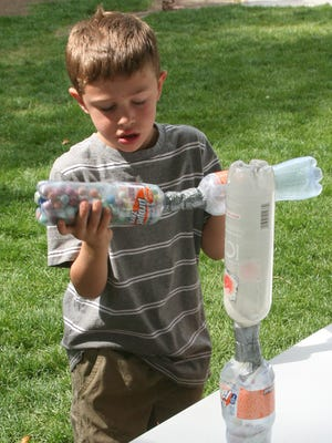 Aiden Pope, 6, tries to figure out an hourglass game during a Day for Kids at Rocket Park in 2012.