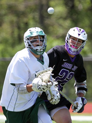 From left, Yorktown's Luke Palmadeso (11) and John Jay's Ryan Lee (22) battle for ball control during the boys lacrosse Class B quarterfinal playoff game at Yorktown High School  May 17, 2014. Yorktown won the game 12-5.