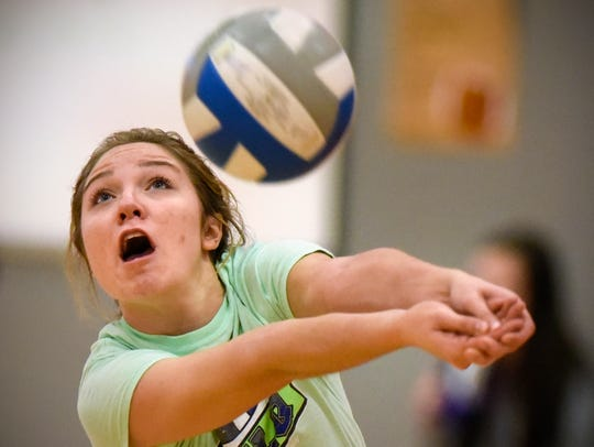 Morgan Holthaus returns a serve during volleyball practice