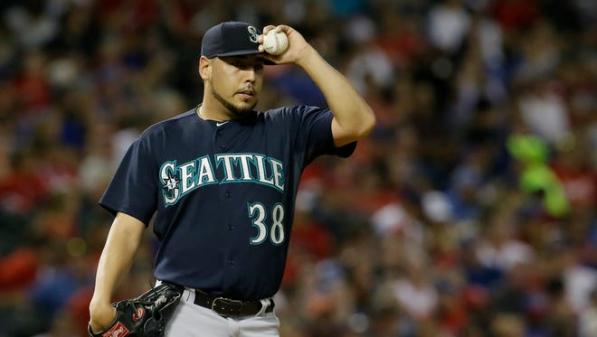 Seattle Mariners starting pitcher Vidal Nuno composes himself during a baseball game against the Texas Rangers in Arlington, Texas, Saturday, Sept. 19, 2015.