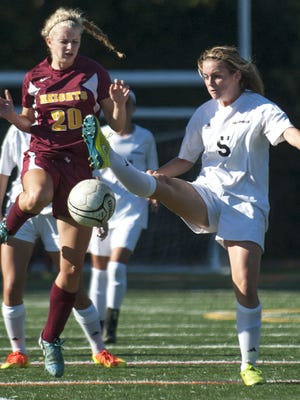 Haddon Heights' Kiersten Pease, left, and Haddonfield's Lizzie Mulvenna battle for ball control during Thursday's 2-1 win for the Bulldawgs.