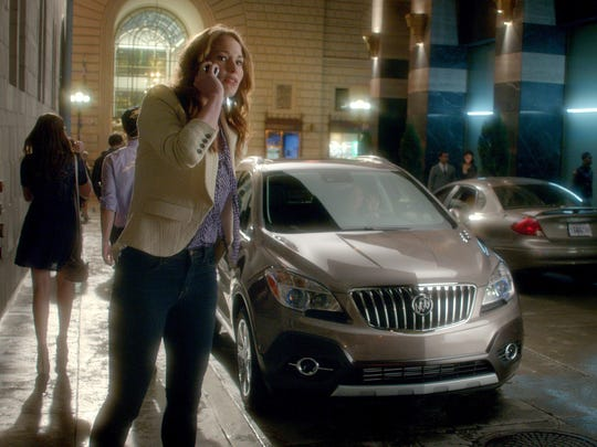 In September 2014, GM is giving the Buick commercials a fresh spin: Five new TV spots individually highlight the Encore, Regal, Enclave, Verano and LaCrosse. This is a still image from one of the commercials.
