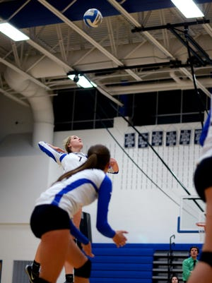 Pioneers Lexie Davidson goes up for a hit Monday, Nov. 2, during district volleyball against Imlay City at Cros-Lex.