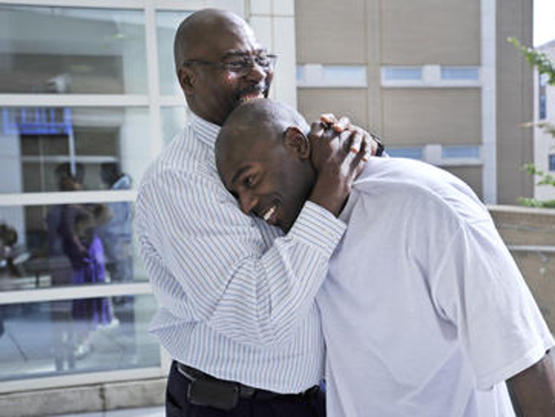 In September 2011, Robert Wilcoxson, right, was embraced