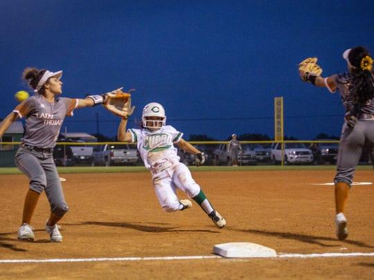Cuero's Maraya Guzman slides into third base during