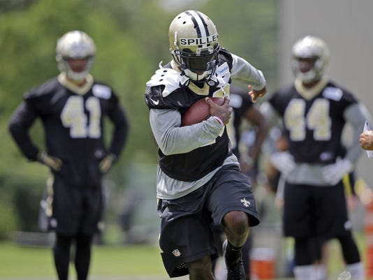 FILE - In this Tuesday, June 16, 2015, file photo, New Orleans Saints running back C.J. Spiller (28) runs through drills during NFL football minicamp in Metairie, La. After missing much of last season a shoulder injury, former Buffalo running back has fresh legs and looks ready to be the type of versatile, explosive threat that fits well with the offense of his new team, the Saints.  (AP Photo/Gerald Herbert, File)