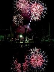 Fireworks light up the sky over Liberty Bay for Poulsbo's Third of July Celebration on Sunday.
