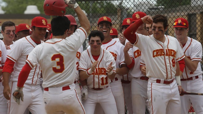 Bergen Catholic greets David LaManna at home plate after he hit his solo home run in the fourth inning against NV/Old Tappan in the BCT. It was the only run of the game and was the winning hit for the Crusaders.