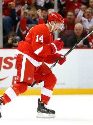 Detroit Red Wings center Gustav Nyquist (14) celebrates his goal against the Tampa Bay Lightning in the second period of an NHL hockey game in Detroit, Tuesday, Oct. 13, 2015. (AP Photo/Paul Sancya)