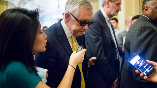 Senate Minority Leader Democrat Harry Reid answers questions about the trade deal this week.