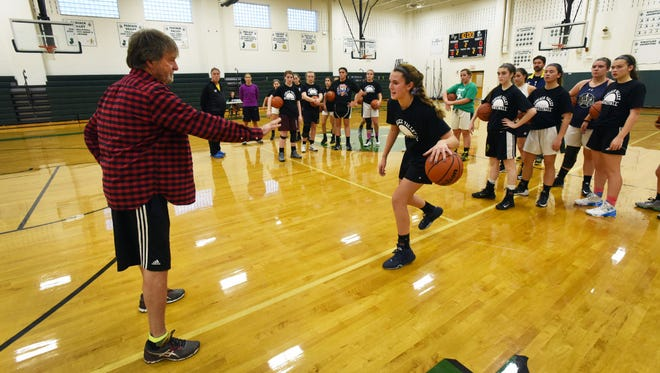 Pascack Valley girls basketball coach Jeff Jasper runs through a drill with junior Kelly Petro during the Indians' first practice of the season on Monday.