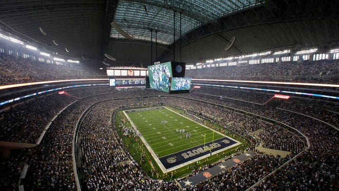 FILE - In this Sept. 8, 2013, file photo, fans watch at the start of an NFL football game between the New York Giants and Dallas Cowboys, in Arlington, Texas. The owboys are worth $4.2 billion, making them the most valuable sports franchise for the second straight year, according to Forbes. (AP Photo/Tony Gutierrez, File)