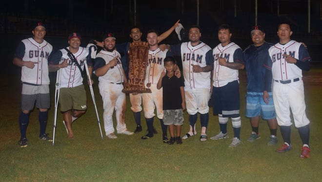 Members of the Guam Men's National Baseball team after their win against Palau, 11-1, in the 2017 Micronesian Classic Goodwill Baseball Tournament.