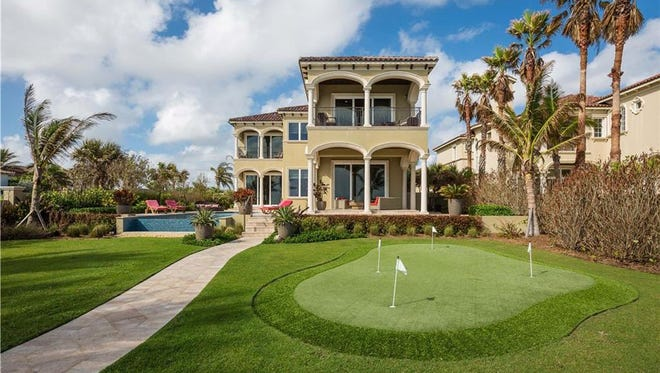 This Vero Beach estate at 3636 Ocean Drive is a putting green and short walk away from the beach.