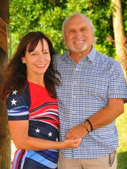 Jacie Stivers, with husband Jim, recently returned from China where she won four silver and two bronze medals at the International Dragon Boat World Championships.